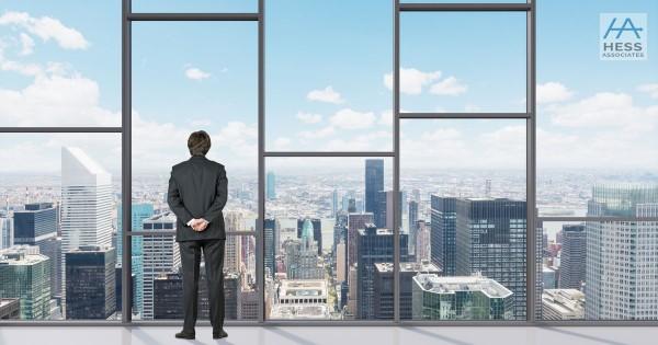 man standing by office window